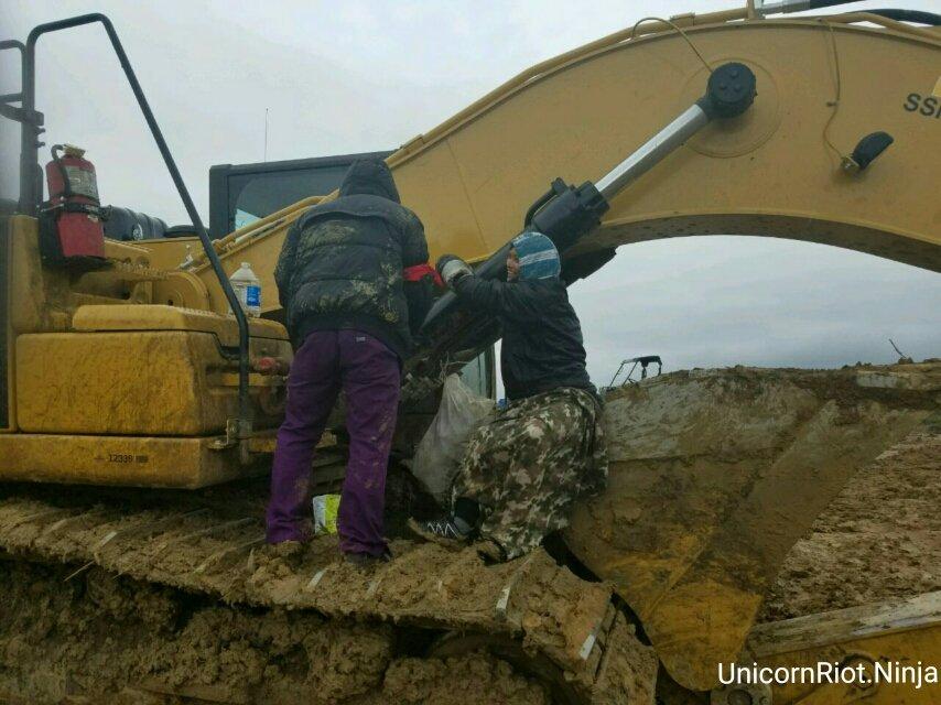 Krissana Mara attaching herself to DAPL excavator with lockbox.