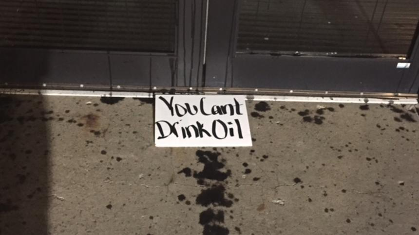 Sign left along with motor oil at North Dakota capitol grounds. Photo via Forum News Service