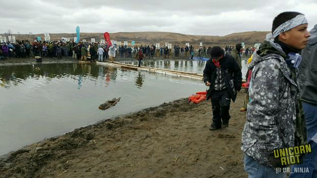 Water Protectors Bridge onto Turtle Island; Mandan Thanksgiving Street Feast