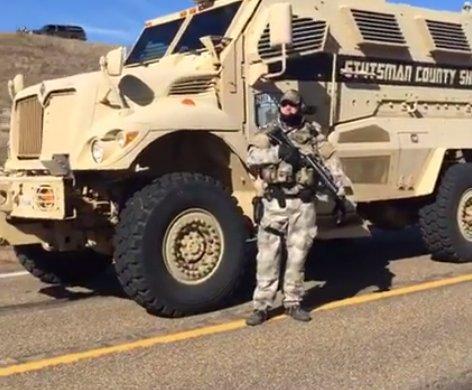 West Dakota SWAT Unit member with Stutsman County MRAP in Morton County on October 10. Screenshot from Shailene Woodley Facebook livestream