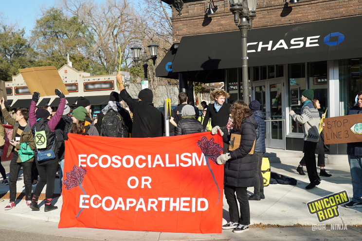 "red banner ""ecosocialism or ecoapartheid"" outside of new Chase Bank branch in St. Paul, MN"