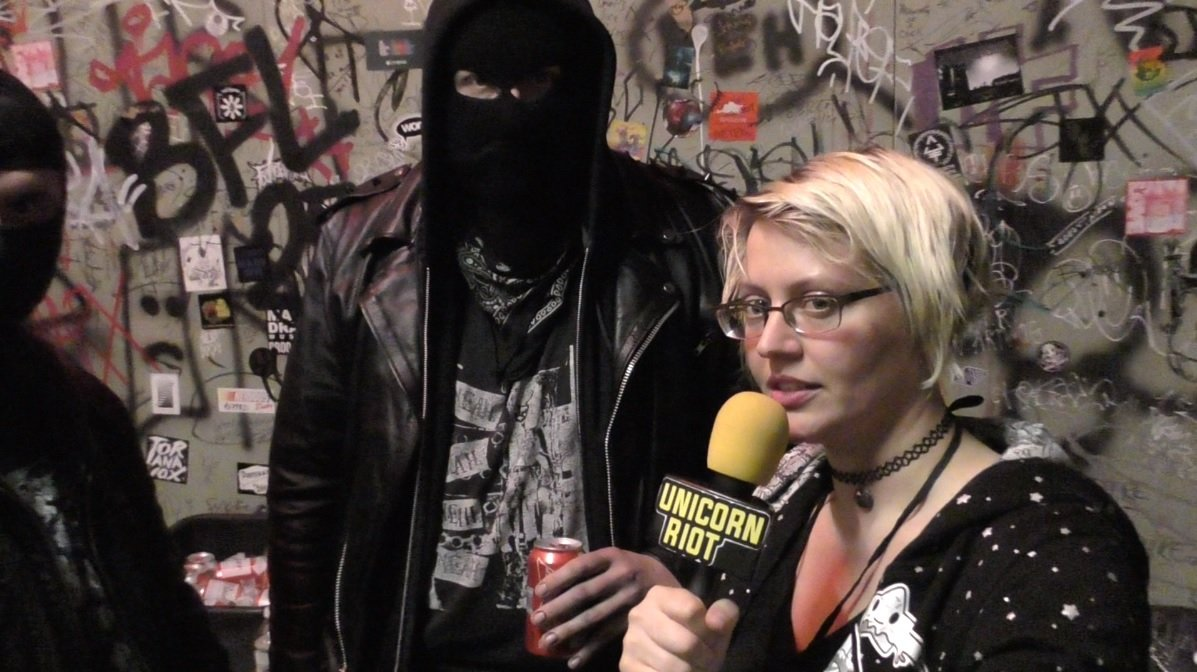 Unicorn Riot journalist Jenn interviewing the band Neckbeard Deathcamp at Black Flags Over Brooklyn Anti-Fascist Metal Festival