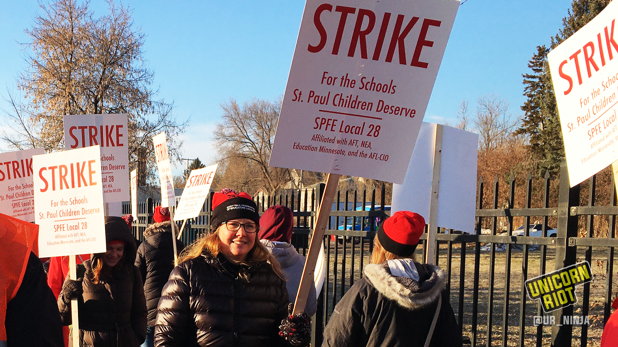 "Saint Paul, Minnesota Educators Union on strike the morning of March 10 outside Washington Technology Magnet School in Minnesota. They are holding signs that say ""STRIKE for the schools St. Paul children deserve, SPFE Local 28"""
