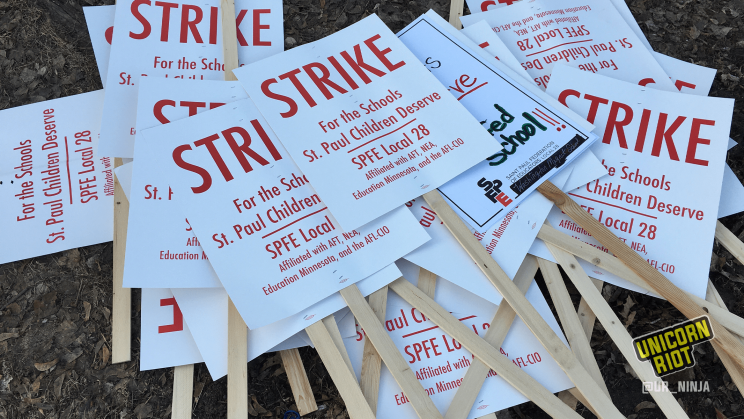 "Pile of strike signs from the SPFE Local 28 labor strike. The signs read ""Strike For The Schools St. Paul Children Deserve."""