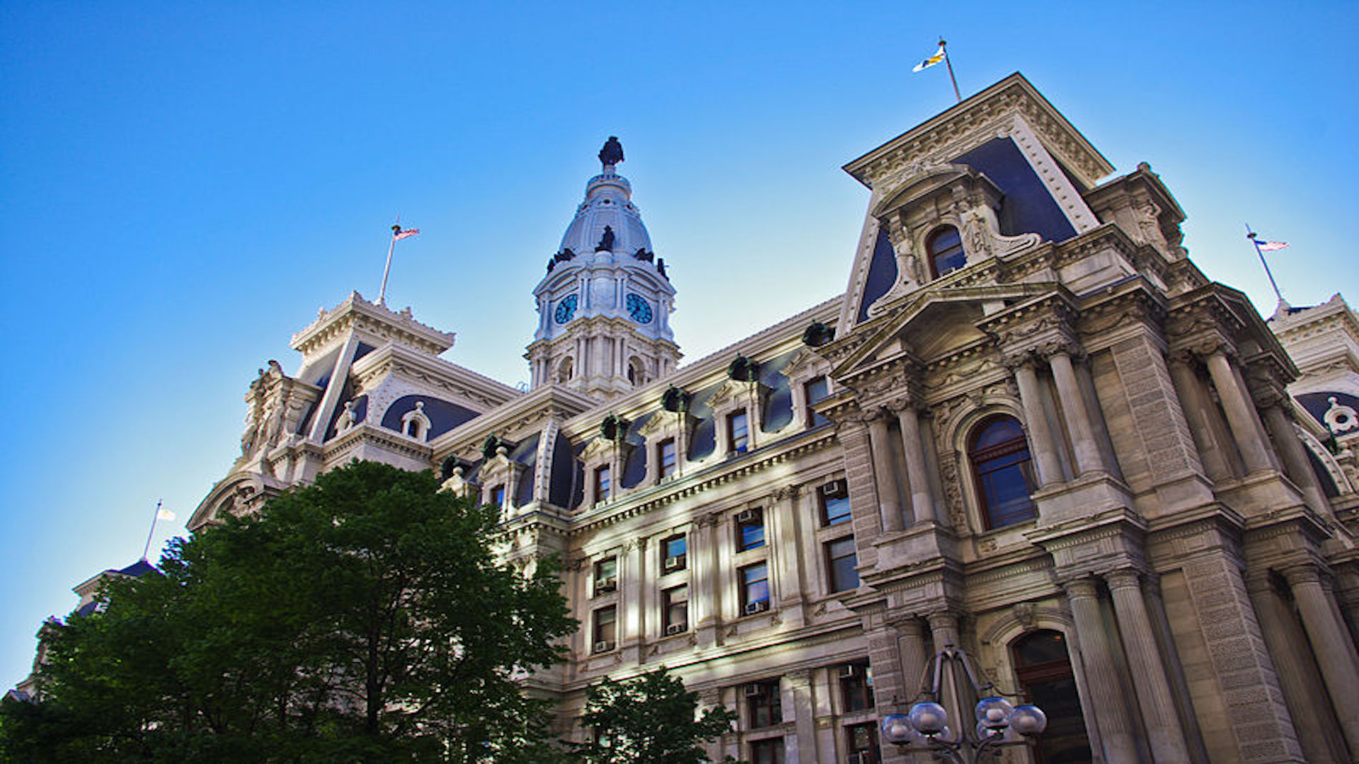 Image of Philadelphia city hall as seen from below. The sky is a deep blue.