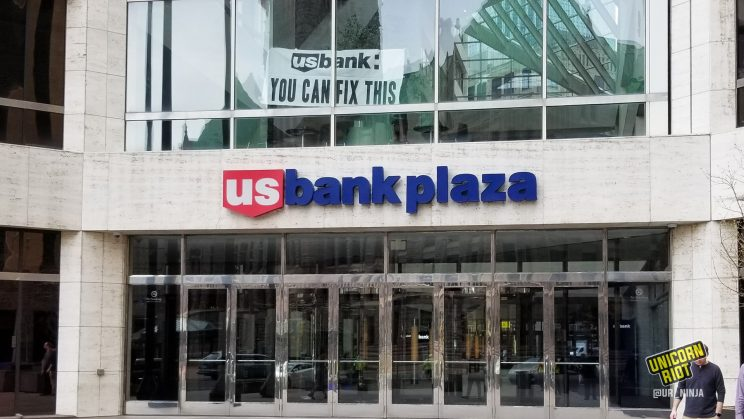 "Banner reading ""U.S. Bank: You Can Fix This"" was unfurled at U.S. Bank Plaza"