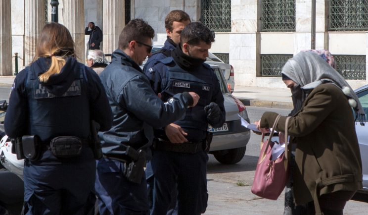 Greek police check papers of people outside during coronavirus quarantine