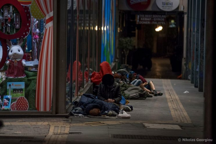 The unhoused sleep on a street in Athens, Greece