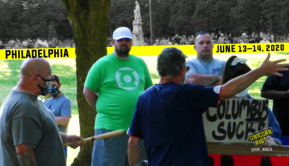 "image: South Philly residents confront anti-racist community members, one of whom has a sign ""Fuck Columbus."" A man is gesturing at her with a bat. Above the scene is a yellow bar with date & location, Philadelphia, June 13 - 14, 2020. In the background as a composite, a crowd is gathered around the Columbus statue in Marconi Plaza in South Philly."
