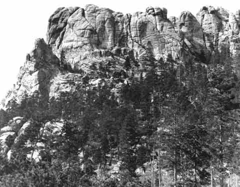 image: the Six Grandfathers mountain in South Dakota in 1905. Today it has been carved into present-day Mount Rushmore.