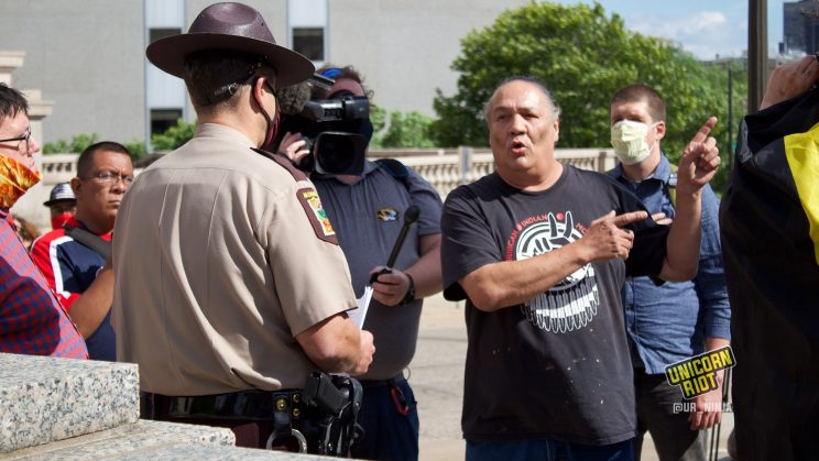Mike Forcia speaks with State Trooper at Minnesota's State Capitol Complex