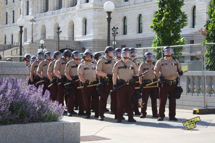 State Troopers line up after Columbus statue taken down