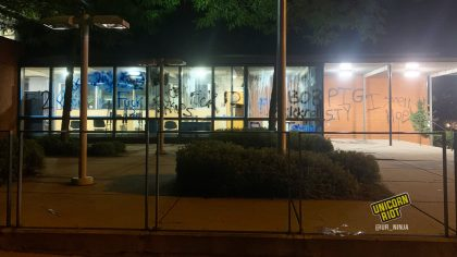 Graffiti on the windows and walls of the 5th Precinct