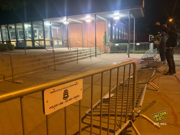 metal barricades were knocked down outside of the 5th precinct