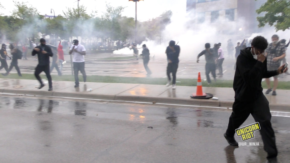 Crowds run away covering their eyes from the CS Gas deployed by Minneapolis Police on May 26, 2020