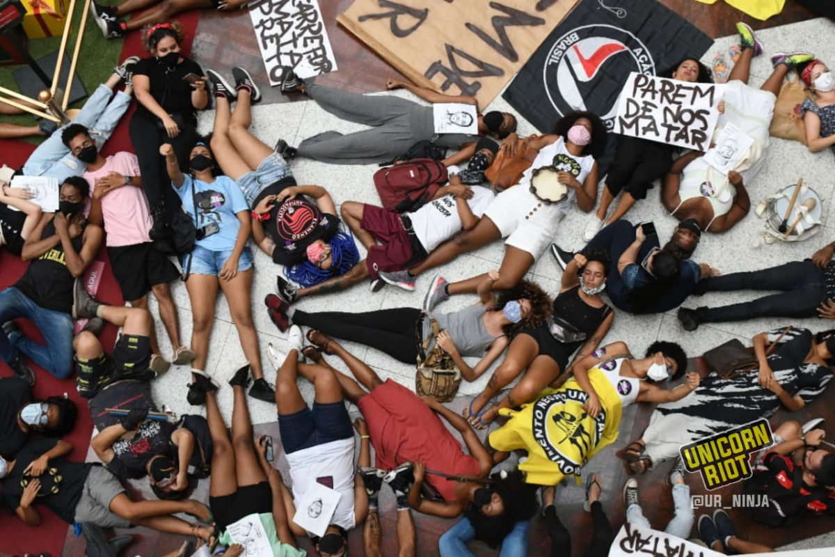 Brazilians participate in a die-in against police violence