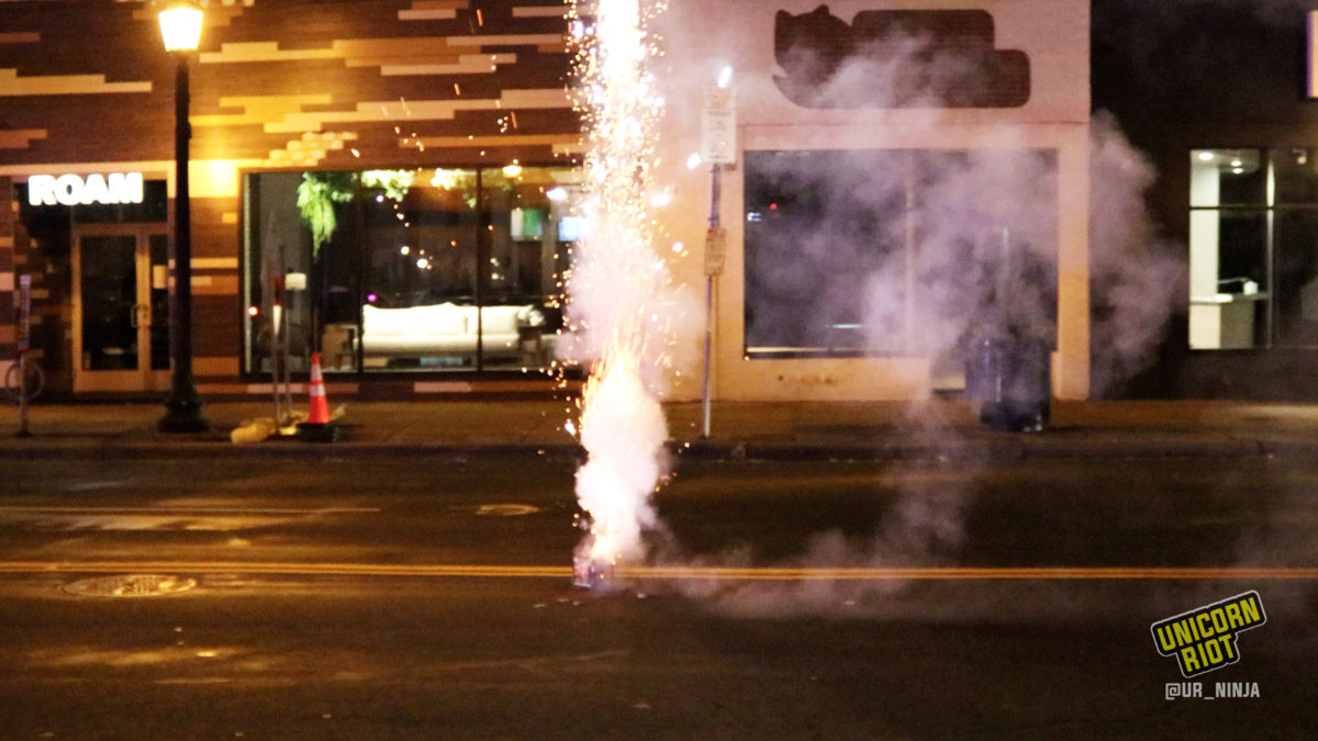 Fireworks are let off on Hennepin Ave in uptown Minneapolis