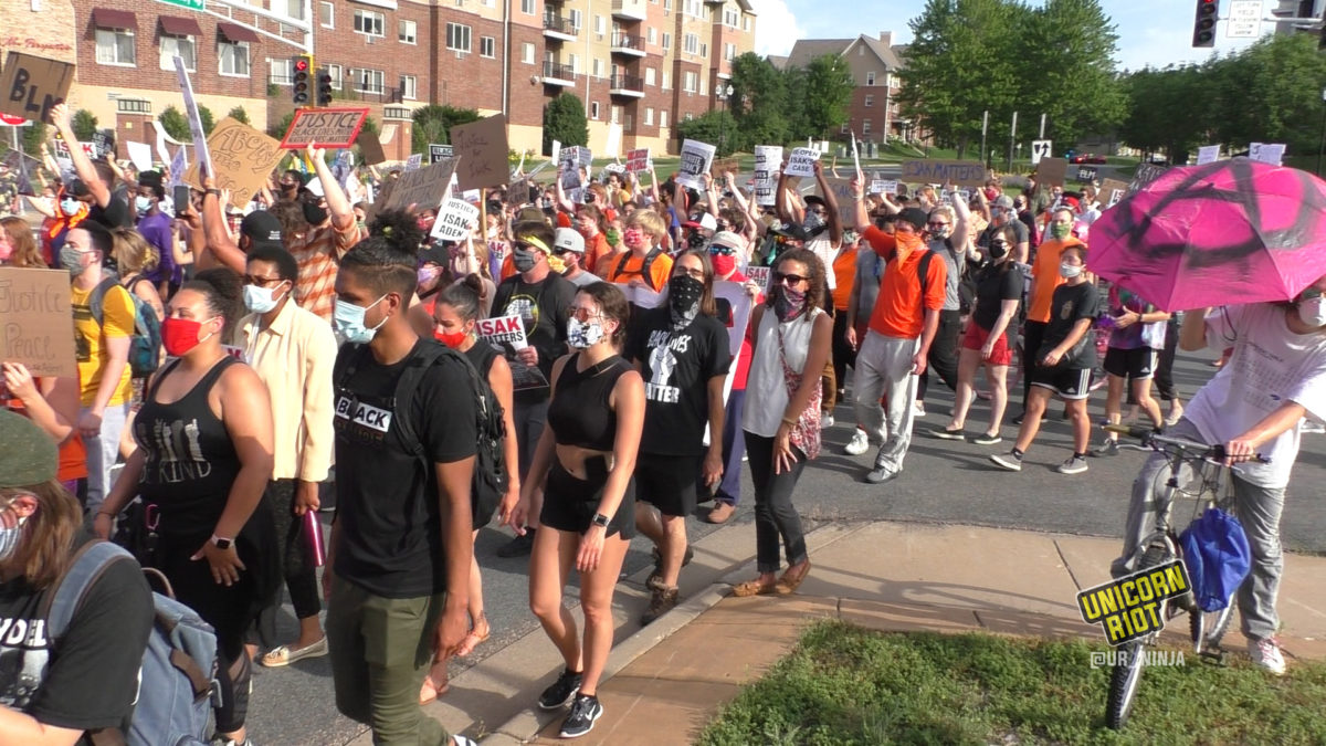large crowd marches in Eagan for justice for isak aden
