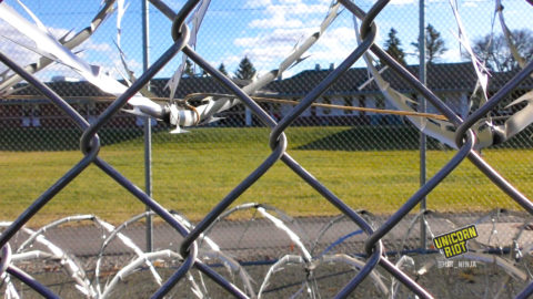 Barbed wire fence surrounds Faribault prison in MN