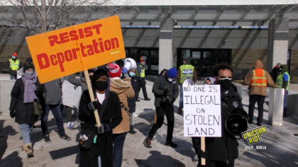 rally at ICE building calling for an end to the war on immigrants