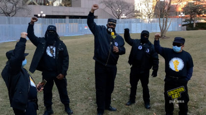 black panther party members and yellow panthers raise their fists outside the hennepin county government center
