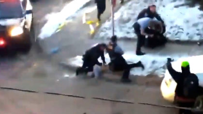 minneapolis police kneeling on a person's neck while they hang off the curb with their face into the concrete